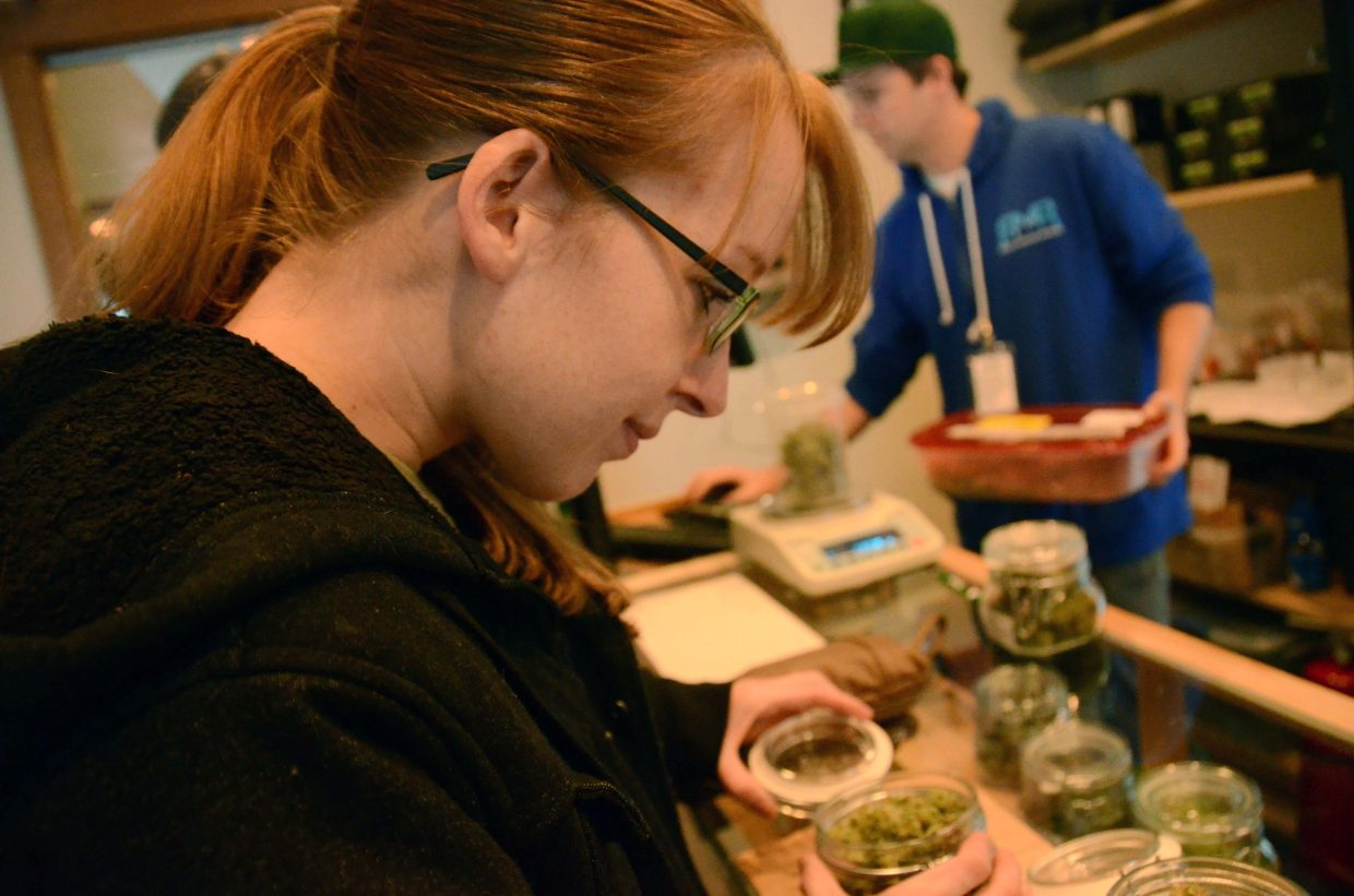 Craig resident Amber Flannery decides what strain of marijuana she wants to buy from Rocky Mountain Remedies in Steamboat Springs. The first retail pot shop to open in Steamboat.