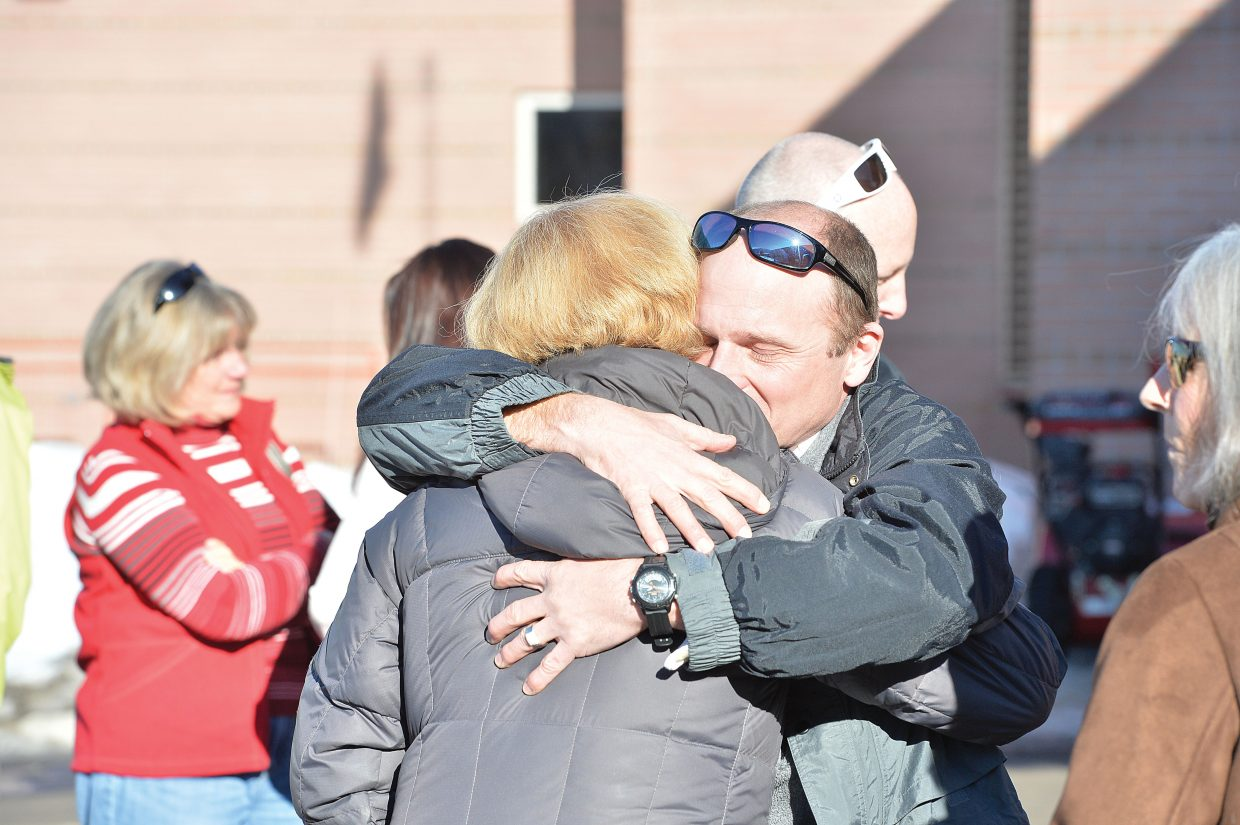Crash survivor Tim Baldwin hugs Anne Barbier at a memorial service recognizing the 10-year anniversary of the crash of a Yampa Valley Air Ambulance flight from Steamboat Springs to Rawlins, Wyoming. The crash killed the pilot, Tim Benway, air ambulance director and flight nurse Dave Linner and flight nurse Jennifer Wells in January 2005. Barbier was the cousin of Wells and was on hand for Friday's services. The plane was en route to Rawlins, about 150 miles north of Steamboat Springs, to transport a patient from Carbon County Hospital to Wyoming Medical Center in Casper. The plane crashed as it made its approach into the airport.