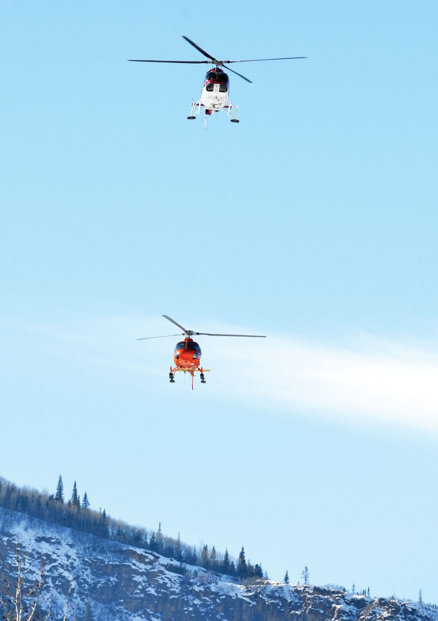 A helicopter from Steamboat-based Classic Air Medical and helicopter from Flight for Life passes over the Yampa Valley Medical Center on Friday as a tribute to the flight crew of Yampa Valley Air Ambulance that died in a crash in January 2005.