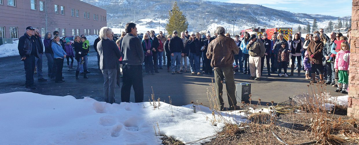 A large crowd listens to Bob Maddox as he recognizes the crew of a Yampa Valley Air Ambulance plane that crashed Jan. 11, 2005, while making its final approach at the Rawlins Airport. The plane, which was en route to Rawlins to transport a patient from Carbon County Hospital to Wyoming Medical Center in Casper, crashed as it made its approach into the airport. Pilot Tim Benway, air ambulance director and flight nurse Dave Linner and flight nurse Jennifer Wells died in the crash. Tim Baldwin, an emergency medical technician at the time, survived the crash and was on hand for Friday's ceremony recognizing the 10-year anniversary of the crash.