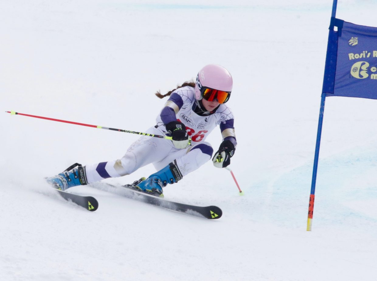MacKenzie Gansmann flies down the course Jan. 8 at a high school giant slalom race at Copper Mountain. She went on to win the event, the first race of the season.