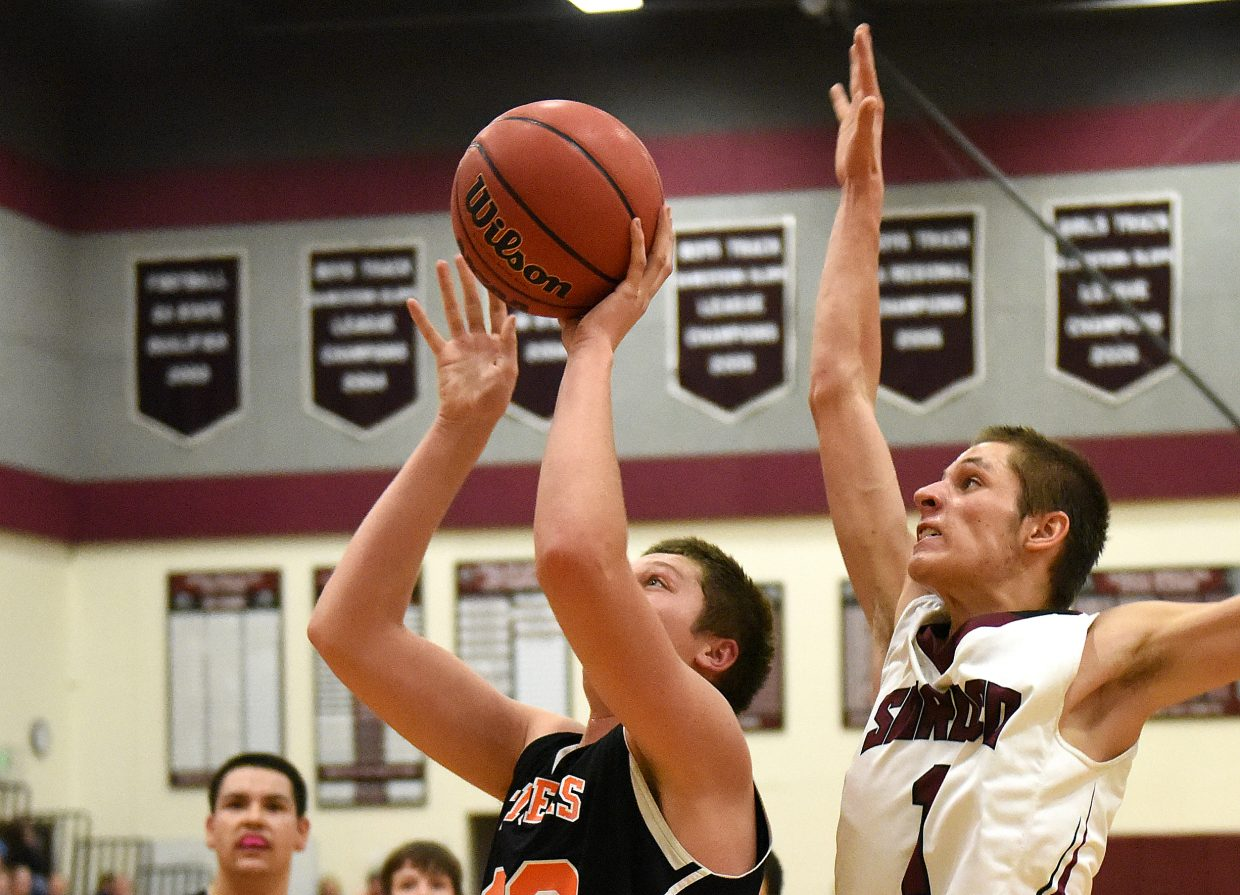 Soroco's Chance Beaty comes up from behind Hayden's Kole Miner on Friday ready for a big block. Beaty made the play, helping kickstart the Rams in what at the time was a close game against their Routt County rivals. Soroco went on to win, 58-45.