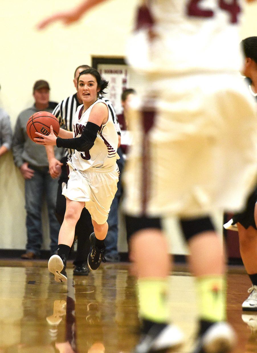 Soroco's Hayley Johnson looks the pass the ball up the court Friday.