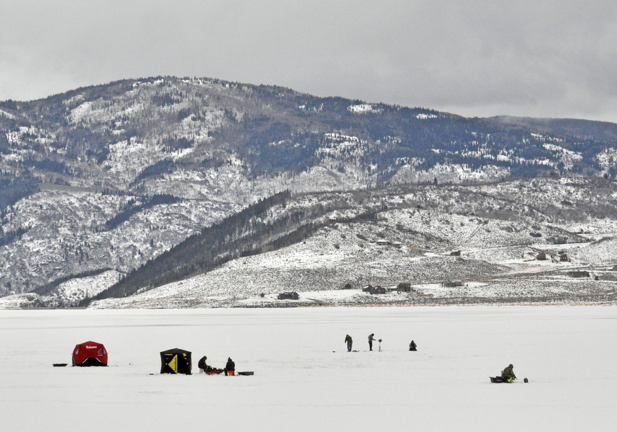 Groups try to lure fish above the ice on Stagecoach Reservoir.