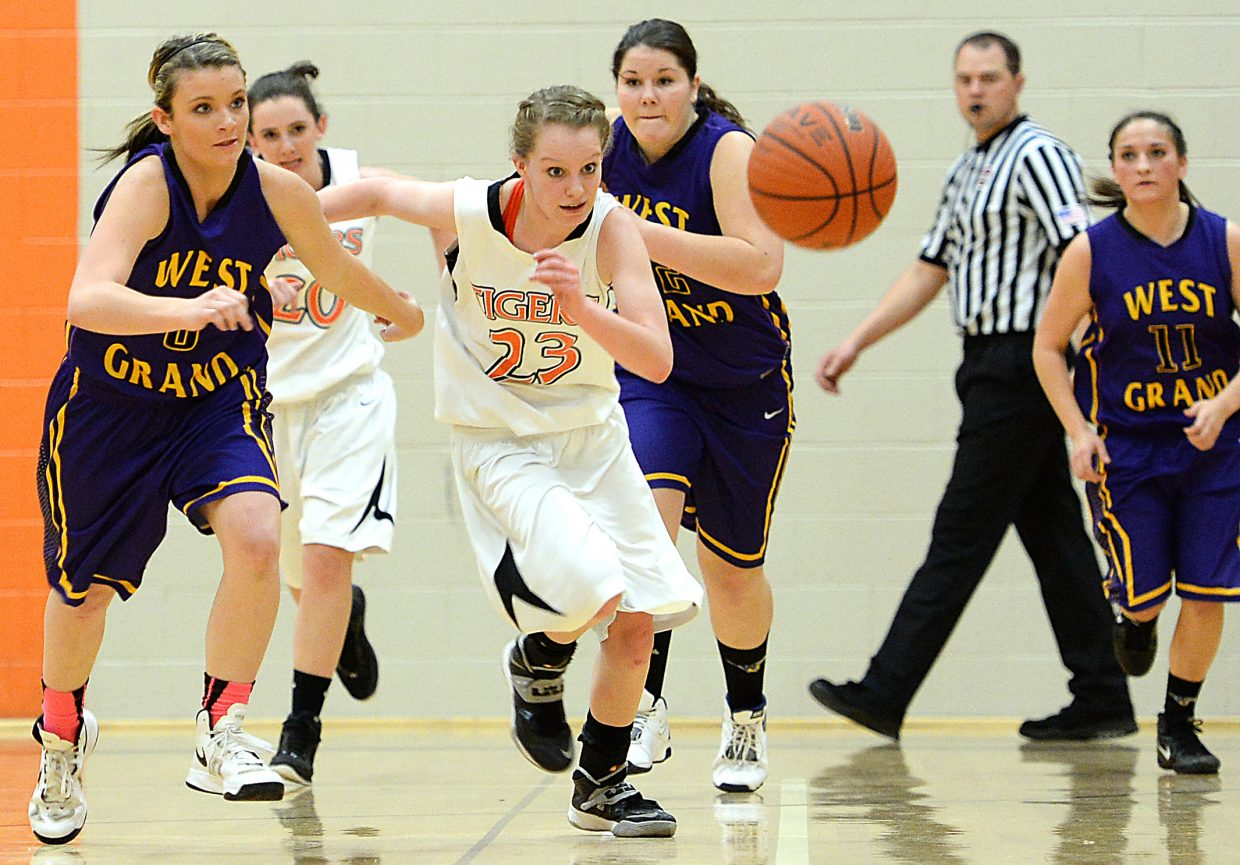 Hayden freshman Grace Wilkie eyes a loose ball Friday against West Grand. At their best, the Tigers won those races and dominated the Mustangs with a fast, fluid pace and a tough defense. Hayden wasn't always that good but still held on for a 41-32 victory.