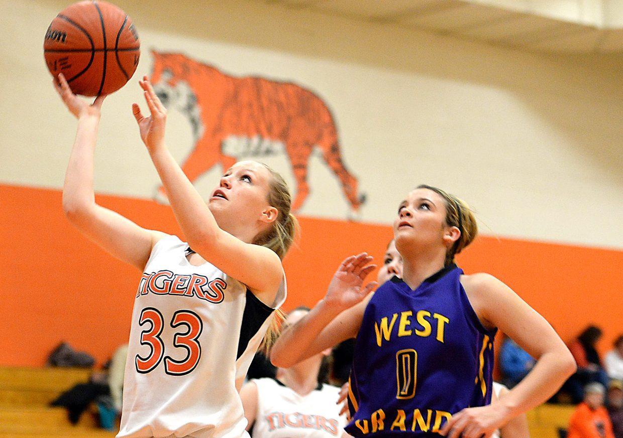 Kenzie Fry goes for a layup Friday against West Grand.