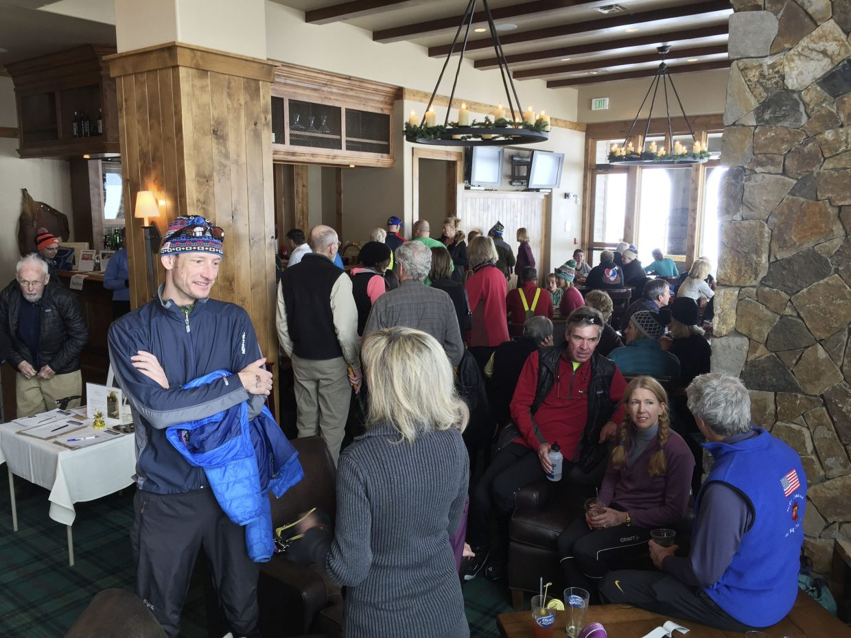 Supporters gather in the Haymaker Nordic Center clubhouse during a Parkinson's disease fundraiser Saturday.