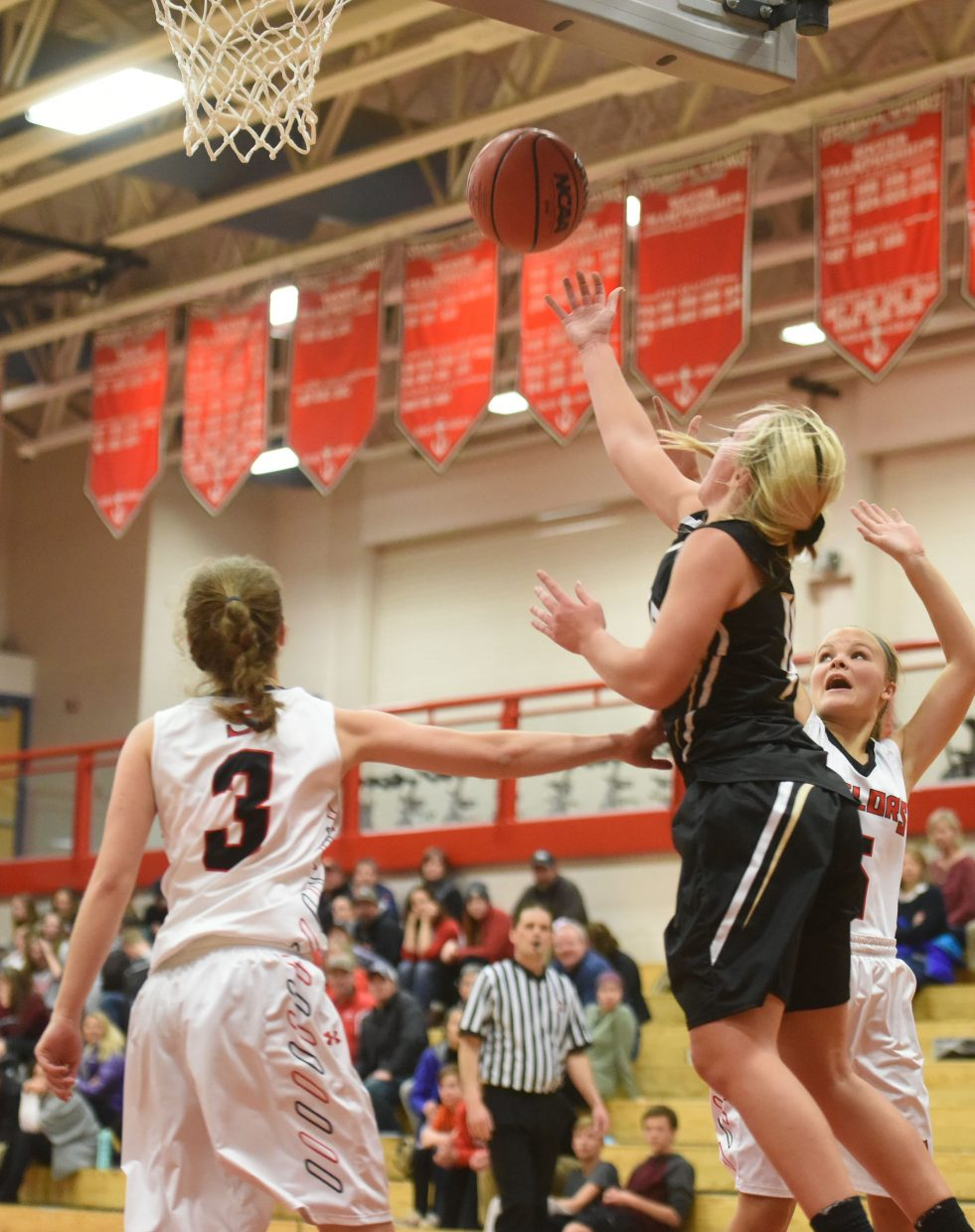 Battle Mountain's Dylan Barker goes up and under with a shot Tuesday against Steamboat. She finished with 18 points to lead all scorers.