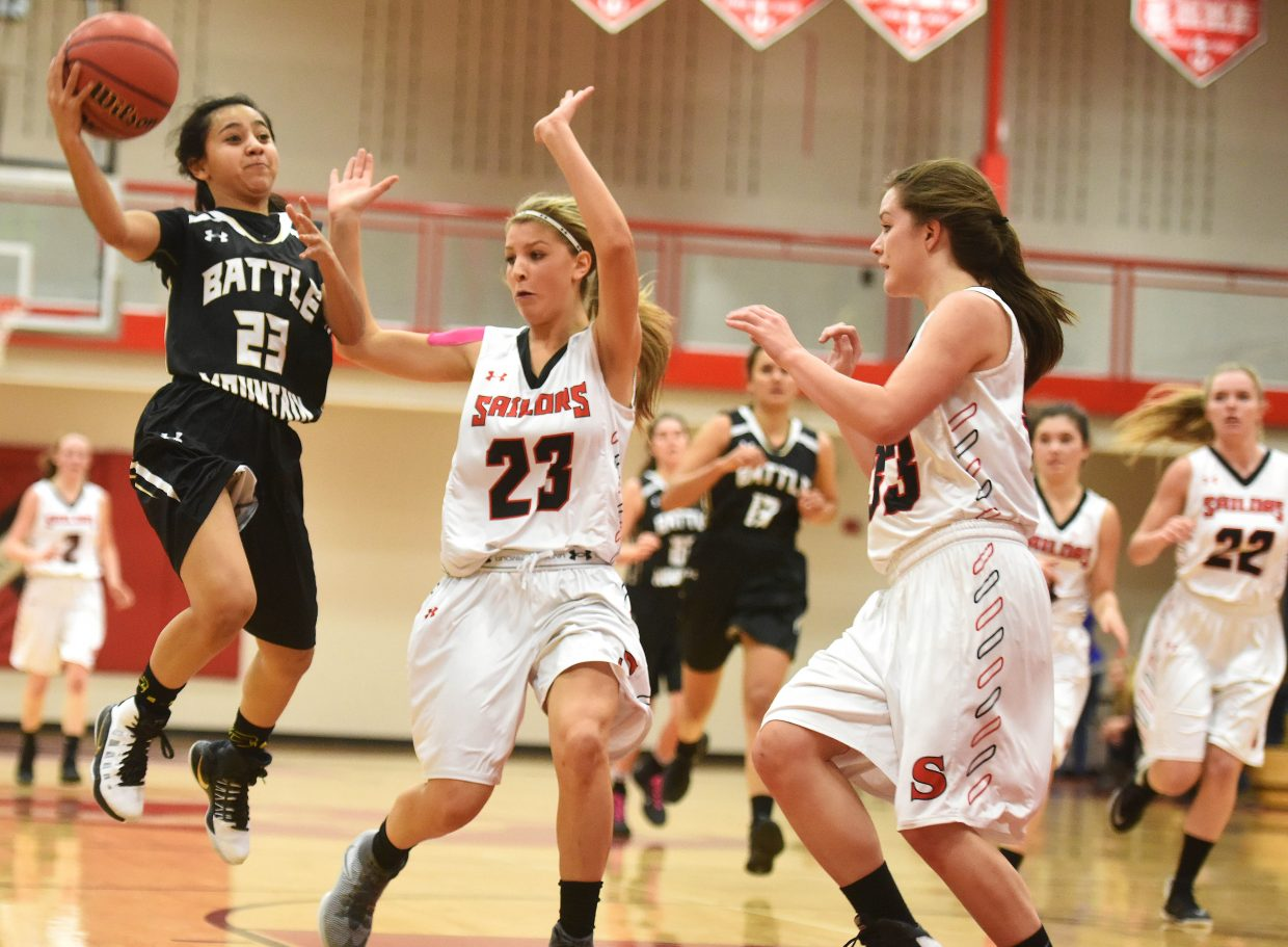 Battle Mountain's Monique Stevens goes up to dish off a pass Tuesday as Steamboat's Izzy Rillos rushes down in defense.