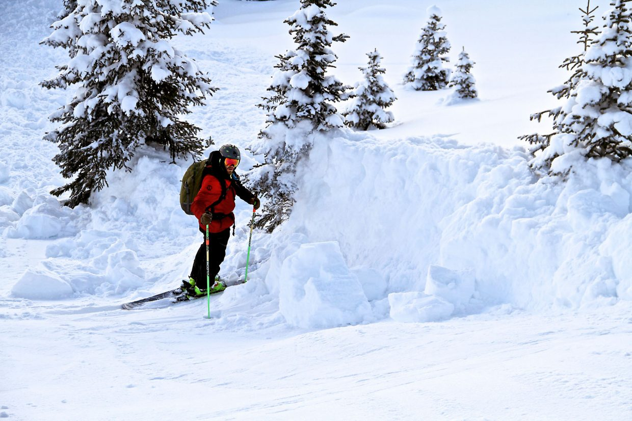 Steamboat Powdercats guide Bill Howard stands at the margin of the Jan. 11 Bitch Creek Avalanche (skier's right), providing scale to the size of the crown that broke on a persistent deep slab sitting on a weaker layer. No one was caught in the slide, although the slope had been skied earlier in the day.
