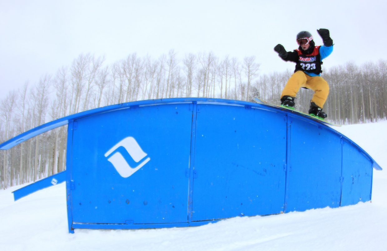 Steamboat snowboarder Cooper Scheel rides a rail during a USASA snowboard slopestyle competition last weekend in Vail.
