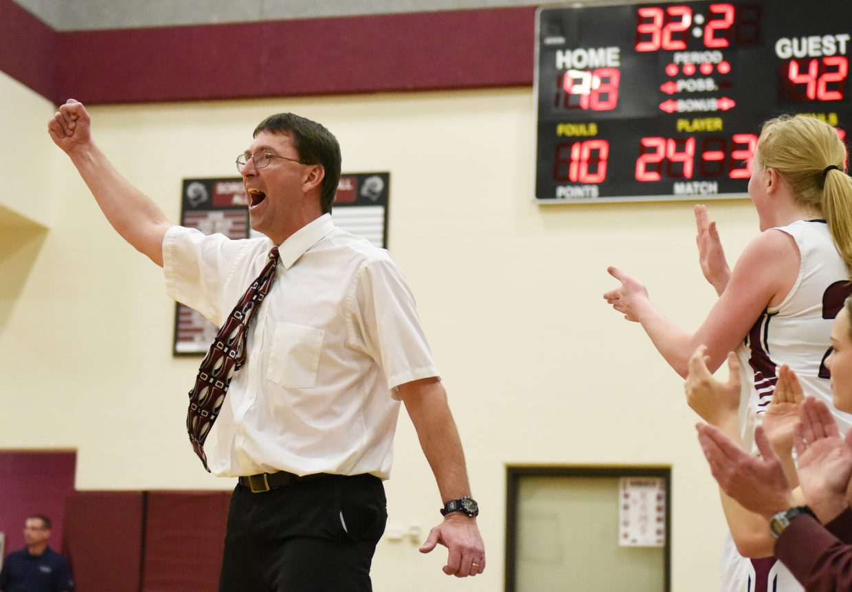 Soroco girls basketball coach David Bruner celebrates a basket late in Tuesday's comeback win against Vail Christian. The Rams trailed by nine at halftime in the game, but won, 52-45.