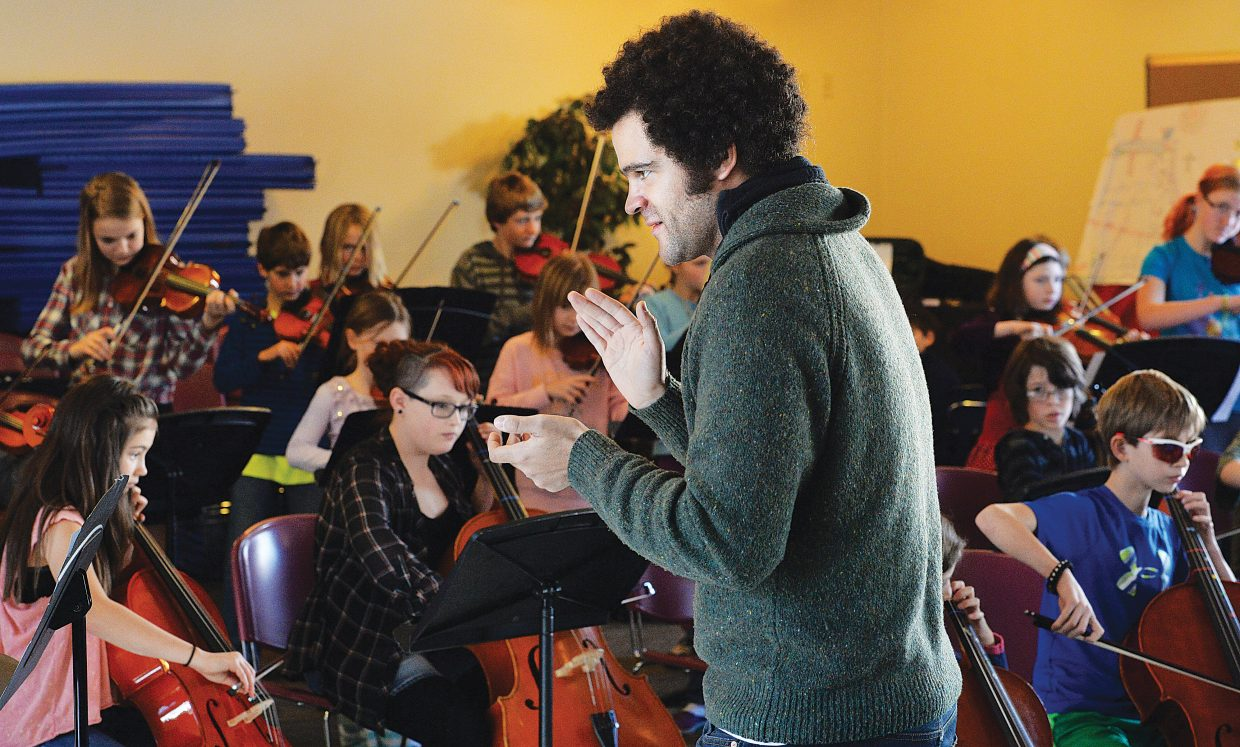 Musician Greg Ward, of JazzReach, works with the students at Emerald Mountain School Tuesday afternoon as part of the Strings School Days. The school days program is sponsored by the Strings Music Festival and connects top artists like Ward with schools in Steamboat Springs and Moffat County.