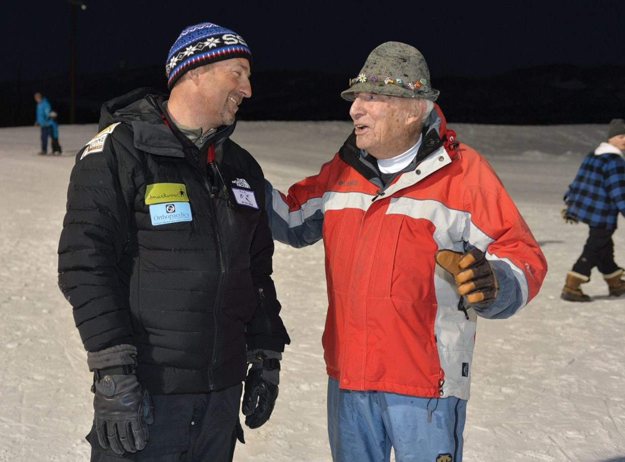Crosby Perry-Smith, 91, visits with Steamboat Springs Winter Sports Club Nordic Director Todd Wilson. Perry-Smith, who coached Wilson when he was a young athlete in Winter Park, was is town Wednesday evening for the 100-year celebration of Howelsen Hill Ski Area. Perry-Smith managed Howelsen Hill in the late 1950s and taught young skiers in Steamboat Springs in all four disciplines of skiing. The city hosted a ceremony Wednesday evening that featured a speech by Perry-Smith and the lighting of the number 100 on the Howelsen Hill jump tower to recognize this historic year for the ski area, which is the oldest in the United States west of the Mississippi River.