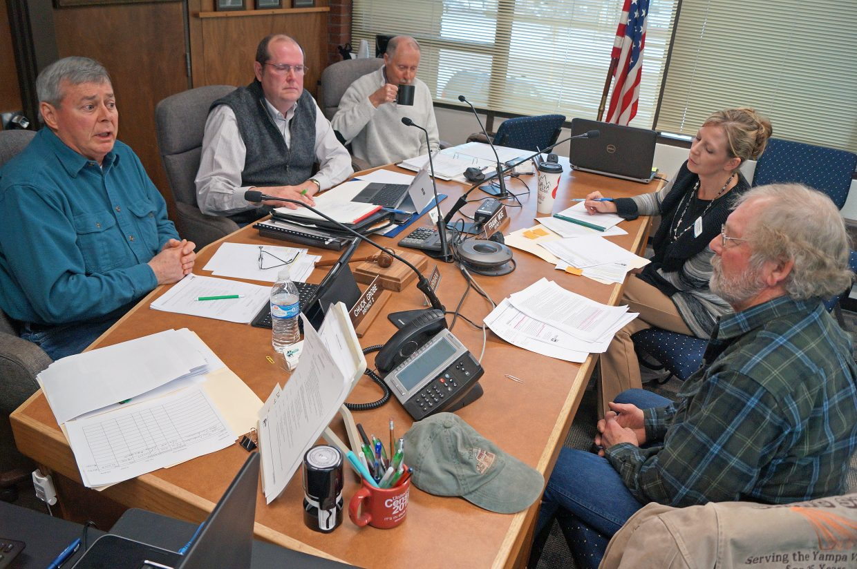 Moffat County Commissioners Chuck Grobe, Frank Moe and John Kinkaid dispute legal concerns with Craig Chamber of Commerce President Don Jones and Executive Director Christina Oxley Tuesday morning.