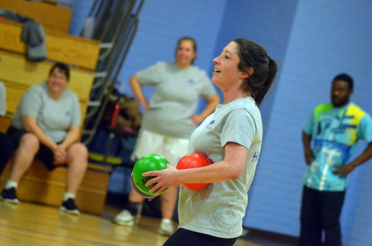 Samantha Myers gathers a cluster of balls and gets ready to throw Wednesday during the Craig Parks & Recreation co-ed dodgeball league. Myers' team, Dodge The Horizons, is one of seven in the first season of the program for adults ages 15 and older.