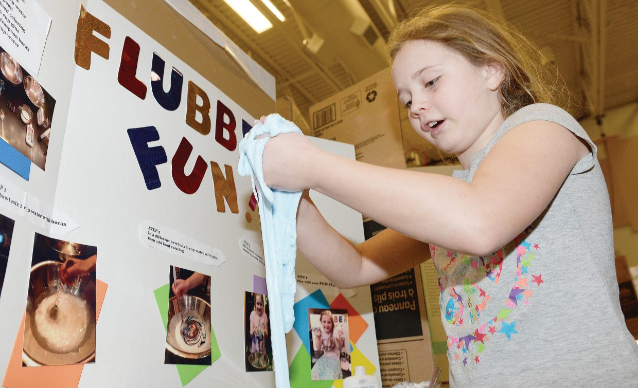 Brooke Bunker has a little fun with Flubber while demonstrating her project Thursday afternoon at the Soda Creek Elementary School Science Fair.