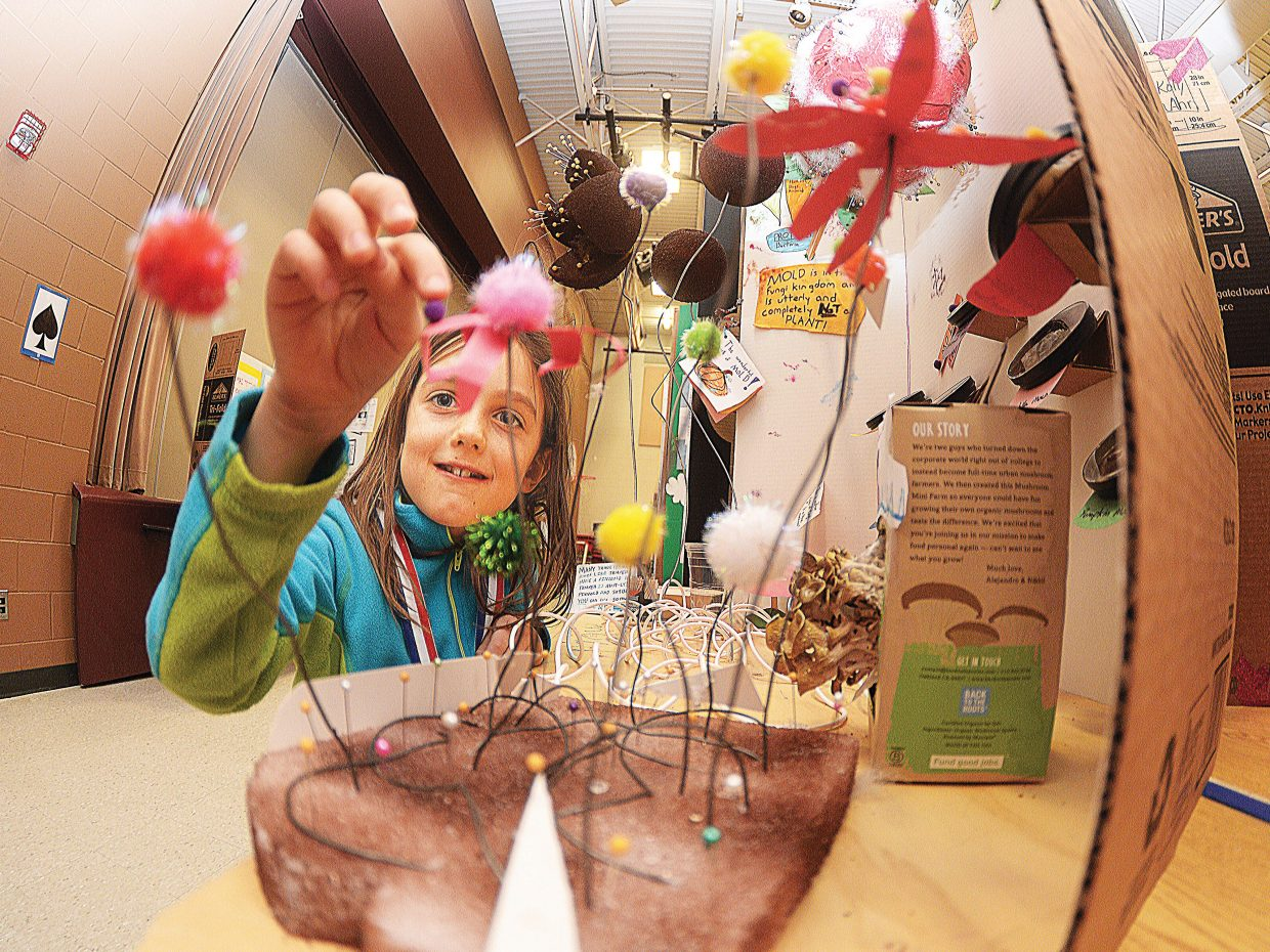 """Second grader Lucy Capra explains her science fair project, """"The Stages of Pin Mold,"""" during a presentation Thursday at Soda Creek Elementary School. The annual science fair featured dozens of projects completed by students from several grades at the downtown Steamboat Springs elementary school."""
