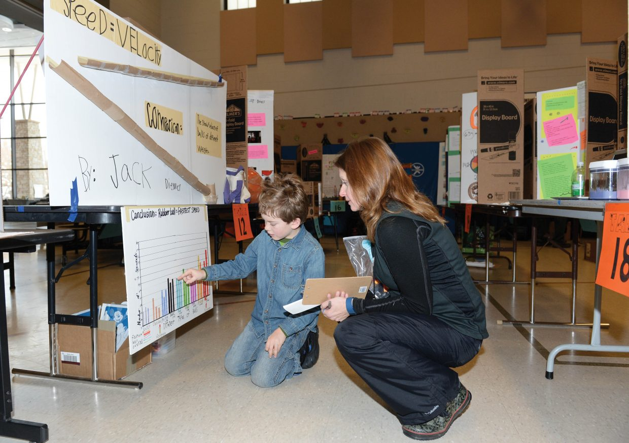 Soda Creek Elementary School student Jack Diemer explains his science fair project to judge Kel Mauldin Thursday in the auditorium of the downtown Steamboat Springs school. The science fair offers a chance for young students to create and display their projects for fellow students, judges and parents each year. This year's fair included enough projects to fill the cafeteria and gym area at the school.