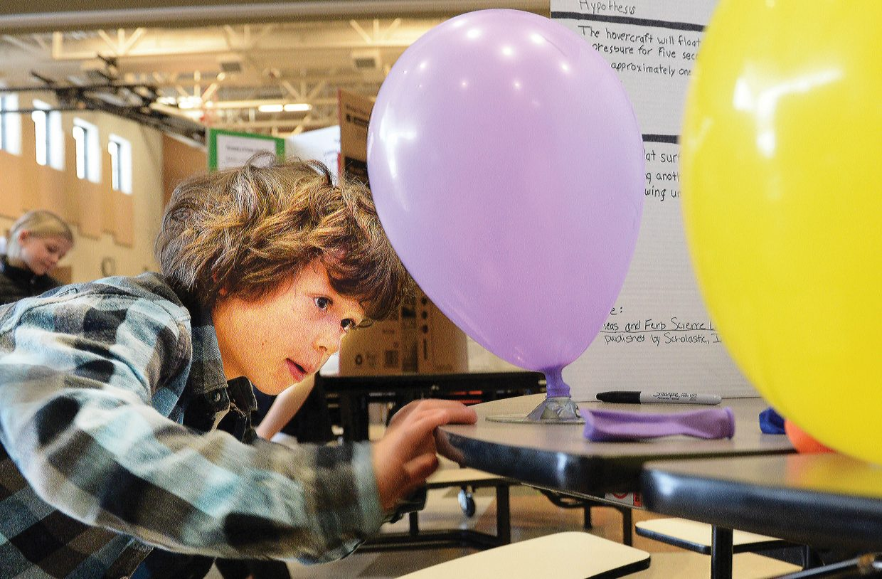 Kodiak Kretzschmar operates the balloon-powered hovercraft he created for the Soda Creek Science Fair on Thursday. The annual event offered a chance for the young minds at the downtown elementary school to create and display their ideas for judges, parents and fellow students. This year, the exhibits filled both the auditorium and cafeteria at the school.
