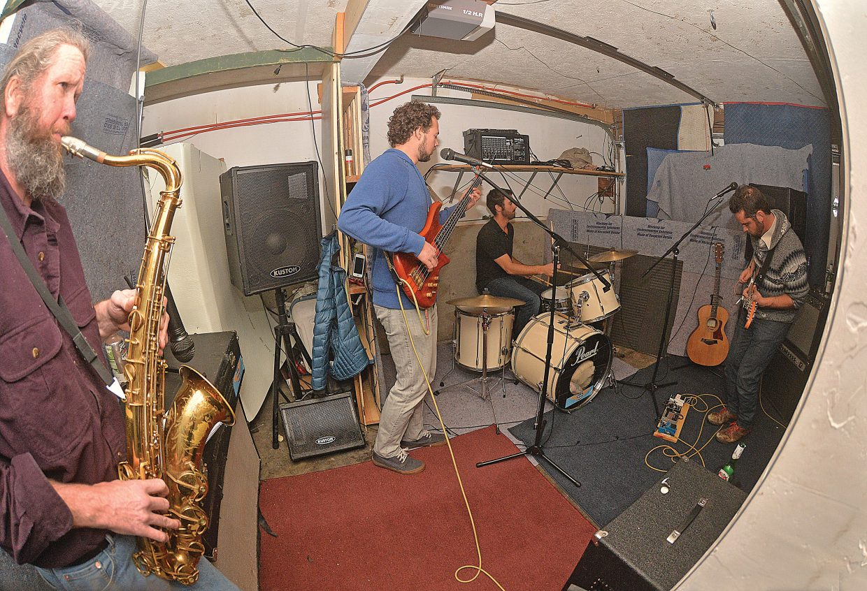 Yer State Birds rehearses in a garage of a Steamboat Springs home.