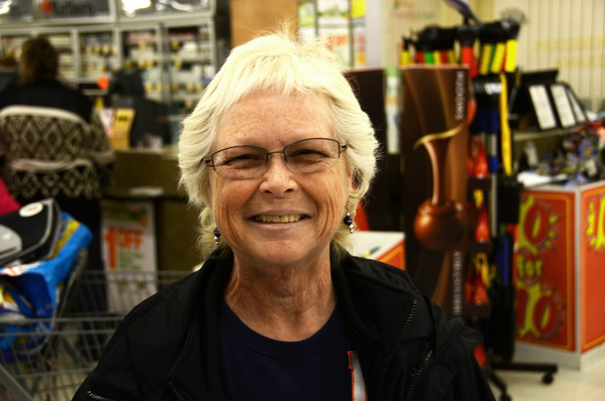 Corky Covertson helped distribute Broncos magnets Tuesday at City Market. She's thriving after a tough battle with breast cancer.