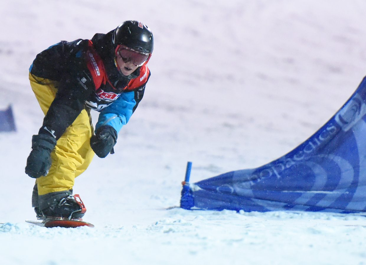 Cooper Scheel stretches for the finish line Friday during an alpine snowboarding slalom race at Howelsen Hill in Steamboat Springs. Scheel won both his class in the slalom, and his class in the giant slalom.