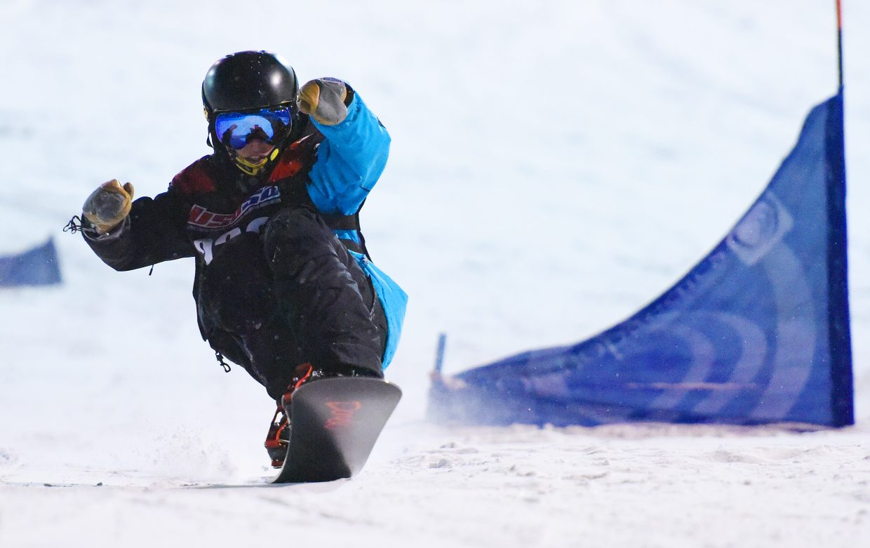 Steamboat Springs snowboarder Winston Vaughan pops up on his board after crossing the finish line at a USASA race at Howelsen Hill.