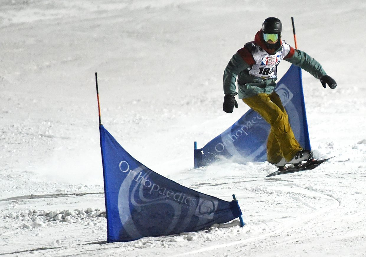 Steamboat Springs rider Billy Winters weaves between gates at a USASA snowboard race at Howelsen Hill.