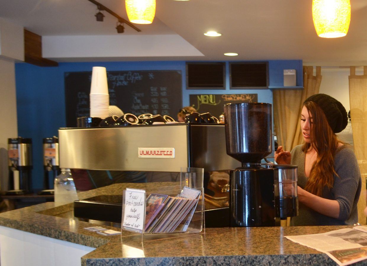 Manager Lauren Berrien prepares drinks on a busy Sunday afternoon at Steamboat Coffee House.