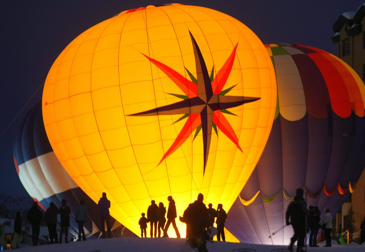 Lighting up the night: Hot air balloons flash to life Sunday evening at Steamboat Ski Area. Hundreds of people gathered at the base of Mount Werner and delighted in the glowing balloons.