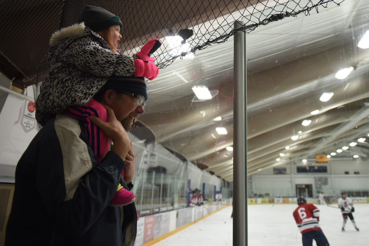 High chair: Scott Barbero ensures his daughter, Eloise, 5, has the best seat in the house Saturday afternoon during the Steamboat Springs High School hockey team's 10-2 home win against Liberty.