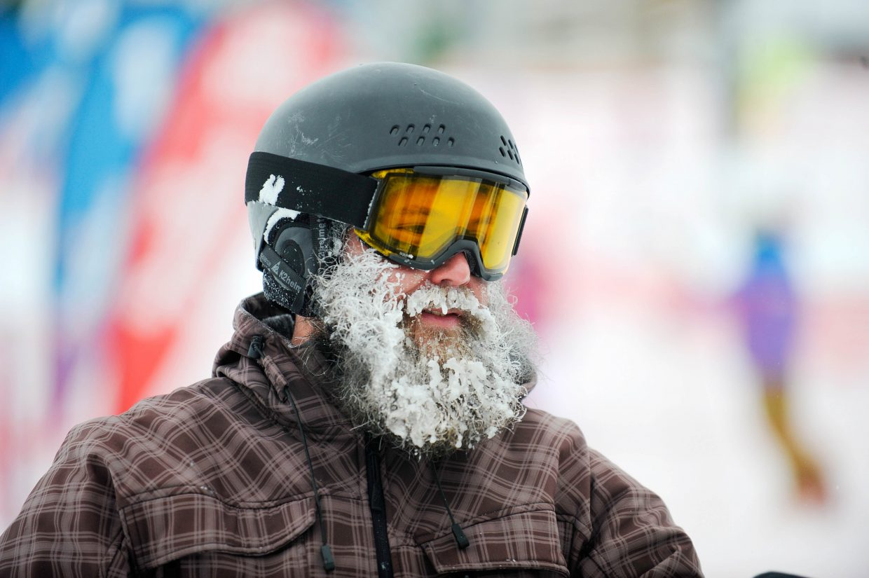 Steamboat Springs snowboarder Paul Smith heads off the mountain after a morning of riding powder Thursday at Steamboat Ski Area.
