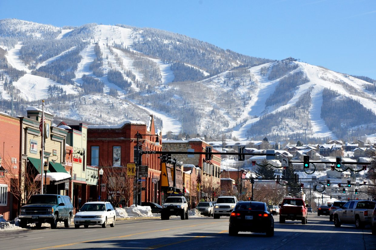 Cars drive down Lincoln Avenue in downtown Steamboat Springs on Thursday afternoon. The city is looking into adding paid parking downtown for the first time.