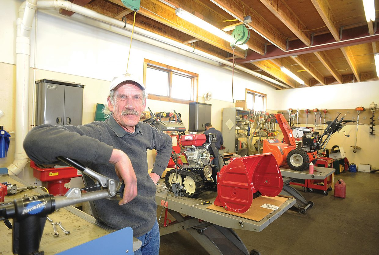 Jim Pavlik, owner of Precision Sharpening and Repair Service, stands inside his repair shop on 13th Street in Steamboat Springs. For nearly two decades, Pavlik has repaired small engines in Steamboat Springs and Routt County.