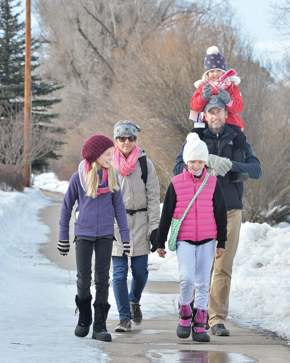 The Edstedt family from Sydney, Australia, took advantage of Friday's warm weather to stroll along the Yampa River Core Trail. The family included, clockwise from left, Ronja, Brigitte, Nick with Freja on his shoulders and Silippa.