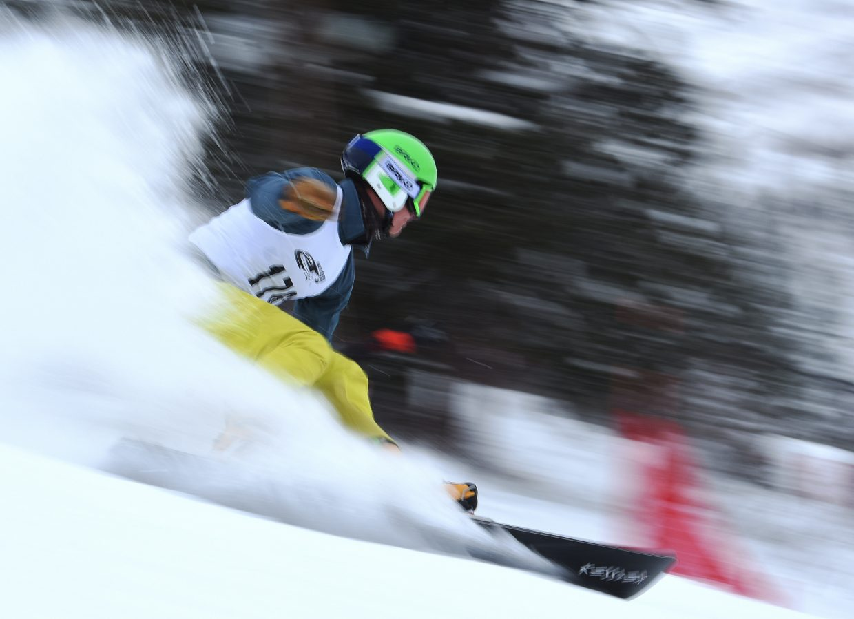 Robbie Burns flies down Howelsen Hill on Saturday during a Race to the Cup parallel giant slalom race. Burns, a Steamboat Springs rider, won the race.