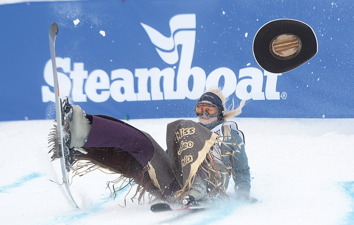 Rodeo queen Jessilea Haga crash lands off the jump during the 43rd Bud Light Cowboy Downhill on the slopes of Steamboat Ski Area last year. This year's Cowboy Downhill is slated to take place at 1 p.m. Monday.