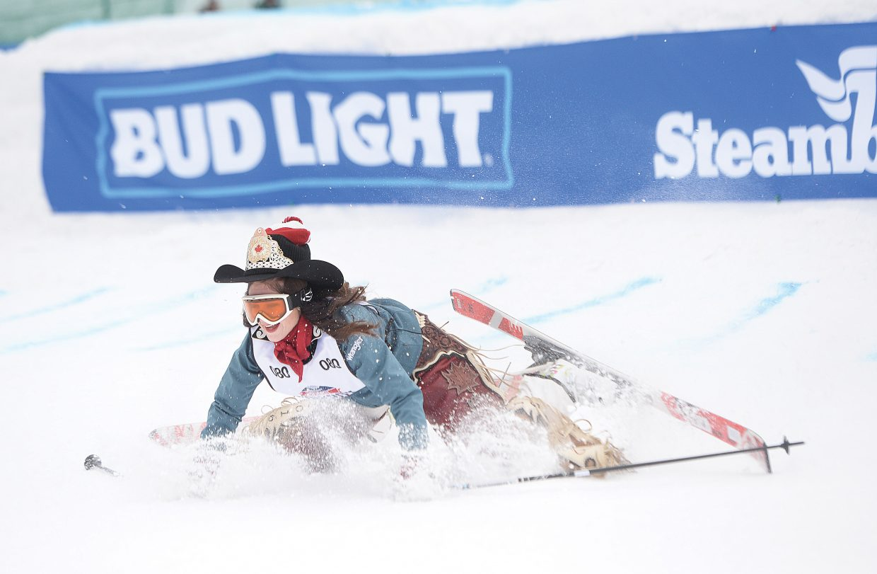 Rodeo queen Ali Mullin crash lands off the jump during the 43rd Bud Light Cowboy Downhill on the slopes of Steamboat Ski Area Monday afternoon. The annual event drew cowboys and cowgirls from the National Western Stock Show in Denver for a day of racing, and a few crashes, on the slopes.