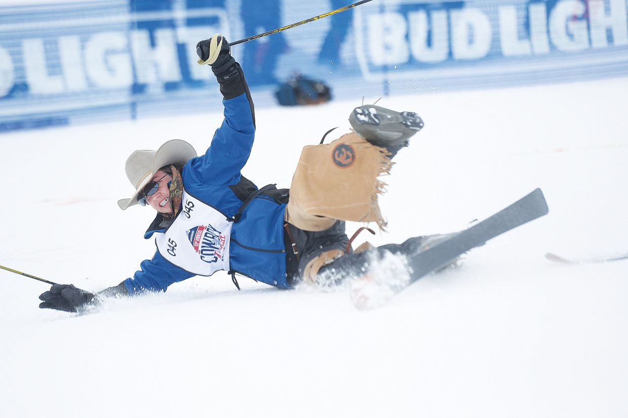 Saddle bronc rider Zane Corey crash lands off the jump during the 43rd Bud Light Cowboy Downhill on the slopes of Steamboat Ski Area Monday afternoon. The annual event drew cowboys and cowgirls from the National Western Stock Show in Denver for a day of racing, and a few crashes, on the slopes.