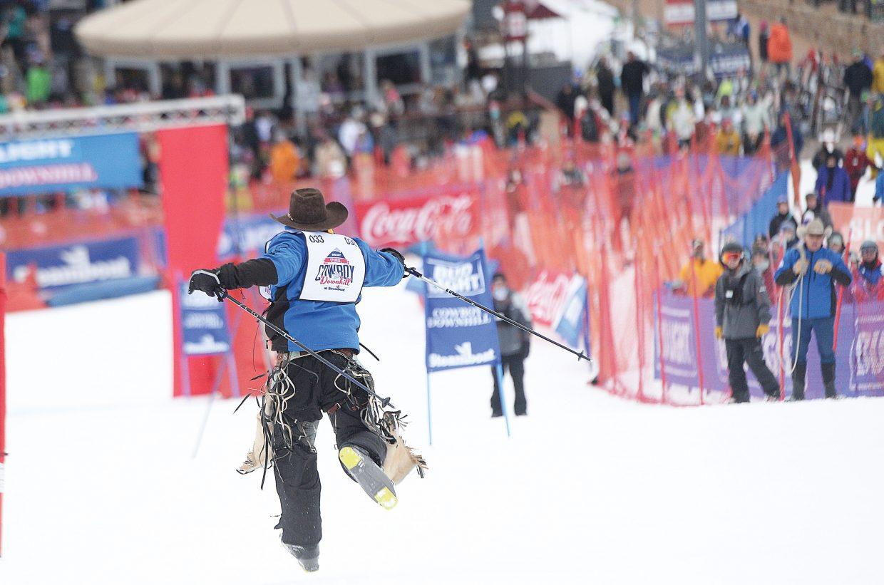 Bareback rider Jamie Howlett runs toward the finish after losing his skis during the 43rd Bud Light Cowboy Downhill on the slopes of Steamboat Ski Area Monday afternoon. The annual event drew cowboys and cowgirls from the National Western Stock Show in Denver for a day of racing, and a few crashes, on the slopes.