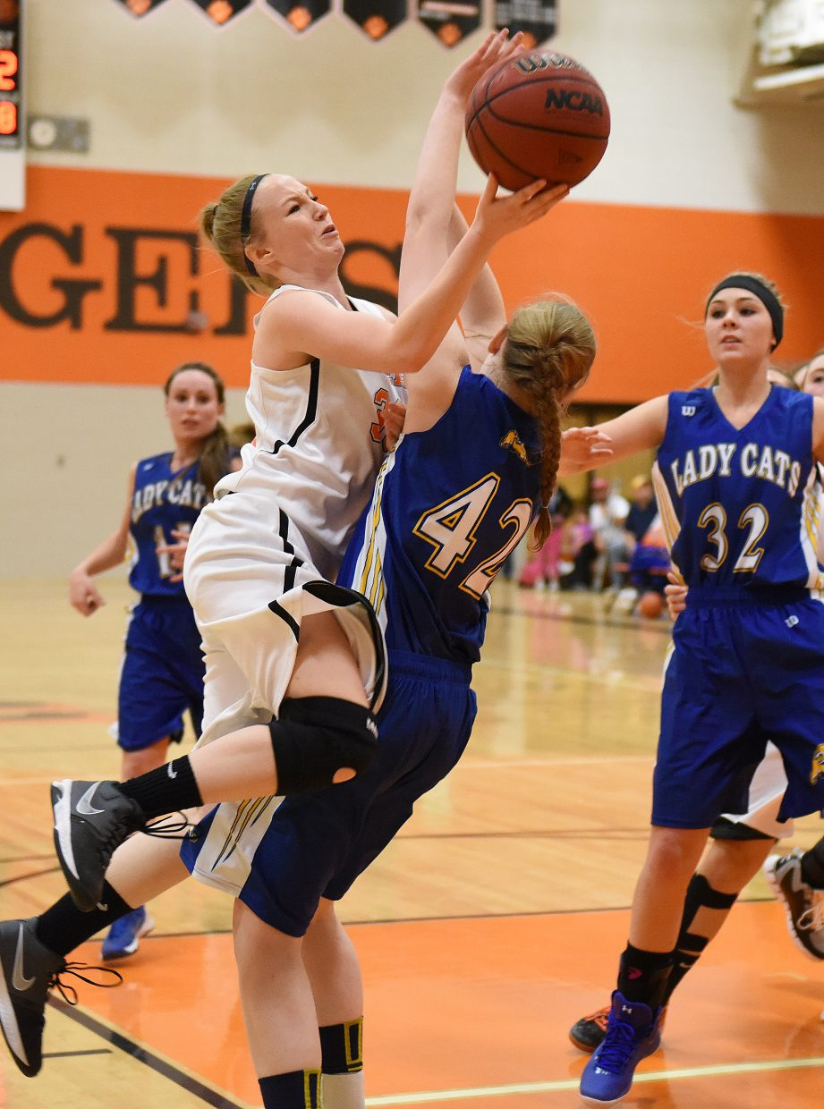 Hayden's Kenzie Fry rolls into a defender in the lane Saturday against North Park. She earned a blocking foul call on the play, but more often Saturday, the whistles were on the Tigers, not for them. North Park scored 17 points from the free-throw line.