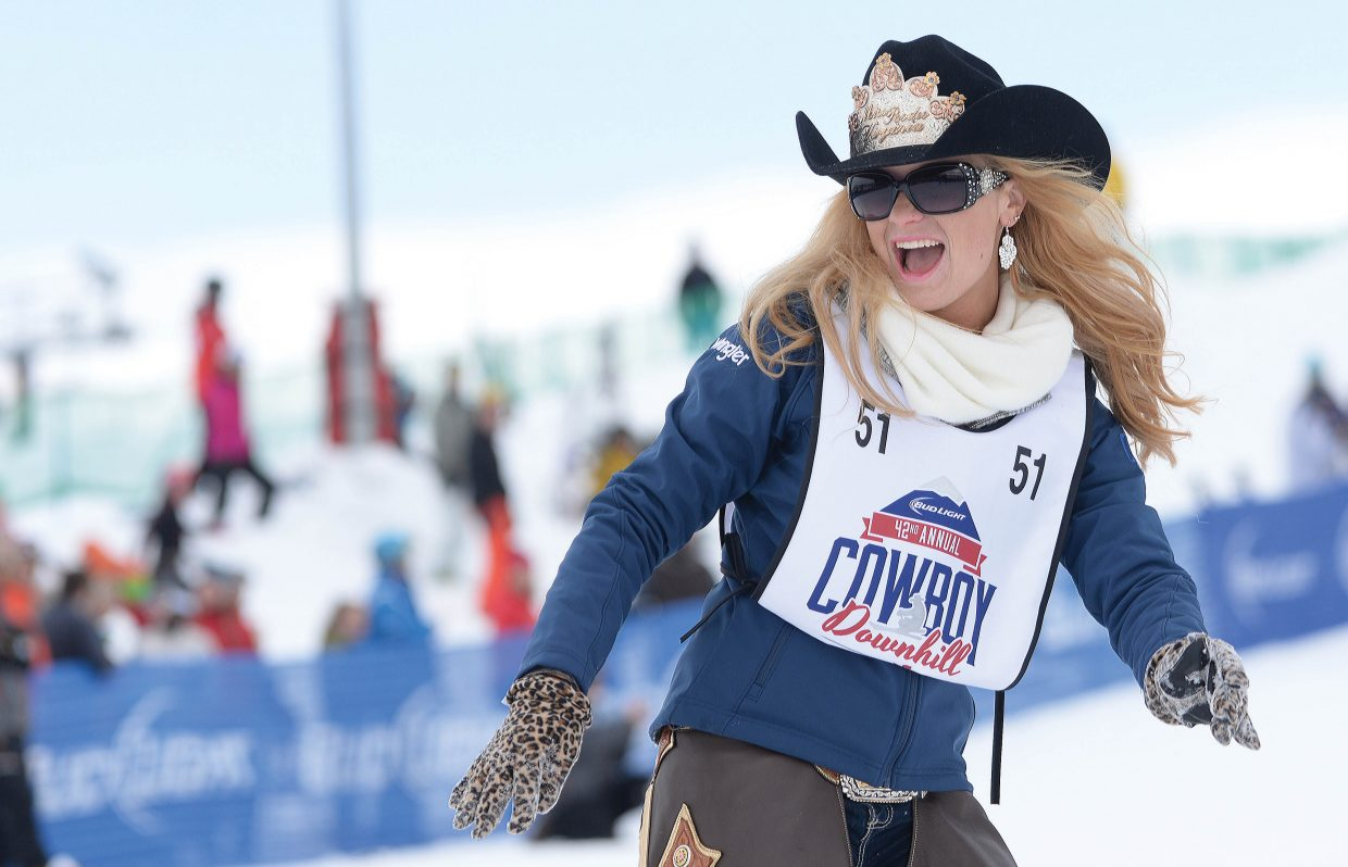 Jane Revercomb, a rodeo queen from Roanoke, Virginia, was all smiles as she made her way down the course during the 42nd annual Bud Light Cowboy Downhill at the base of Steamboat Ski Area Monday afternoon.