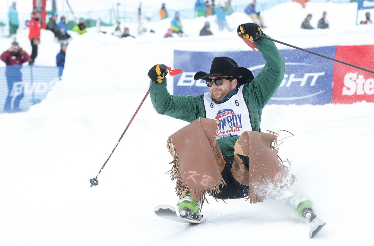 Keith Brauer, a saddle bronc rider from Illinois, attempts to keep his skis under him during the 42nd annual Bud Light Cowboy Downhill at the base of Steamboat Ski Area Monday afternoon. The long-running Steamboat Springs tradition attracts cowboys from the National Western Stock Show in Denver to come to Steamboat Springs to compete in a head-to-head race and the crazy stampede, which included all the cowboys in a free-for-all downhill held at the conclusion of the event.