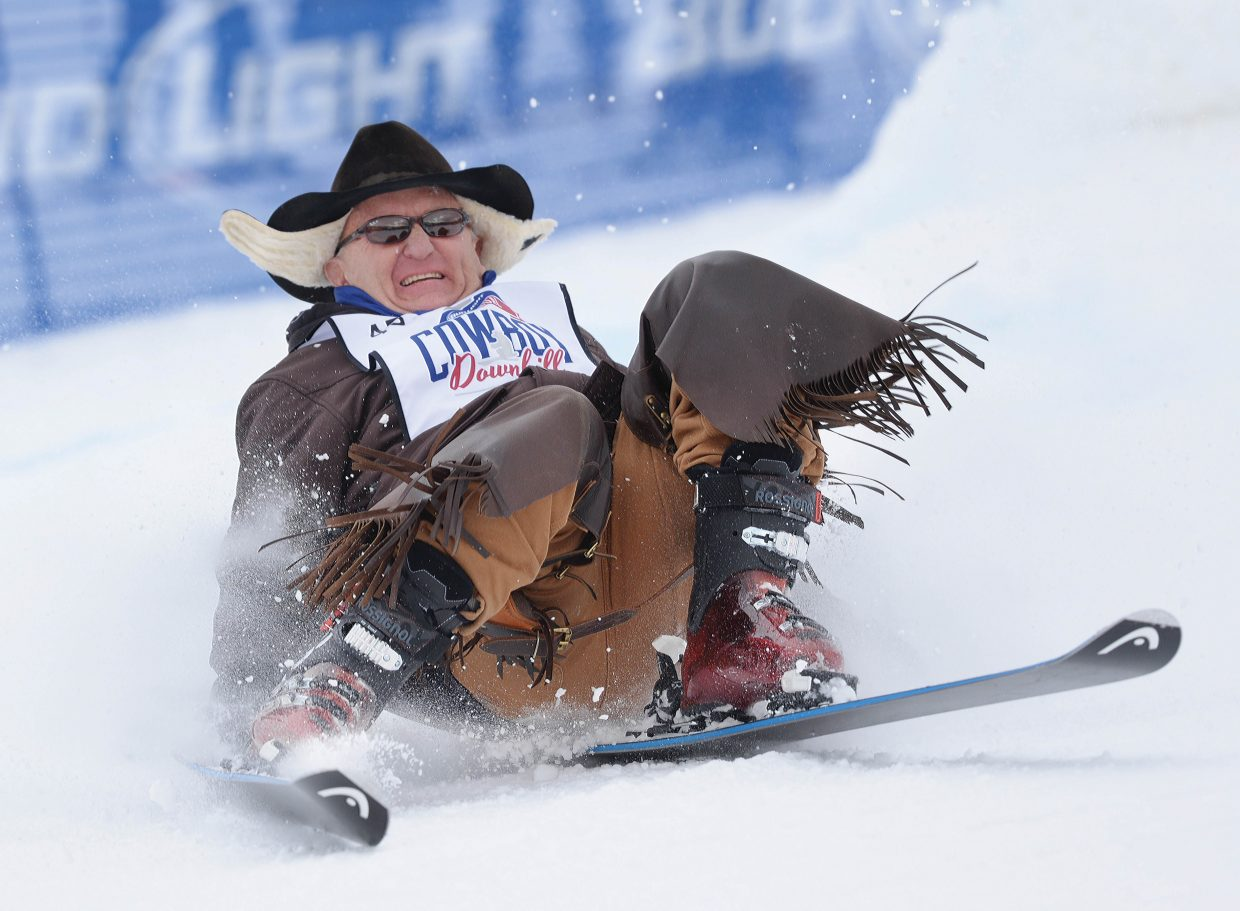 Stock contractor Hal Burns attempts to keep his skis under him during the 42nd annual Bud Light Cowboy Downhill at the base of Steamboat Ski Area Monday afternoon.