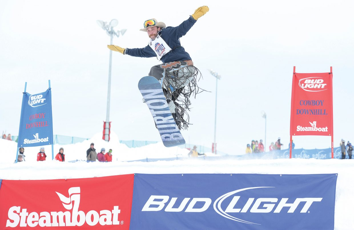 Brady Dinwoodie, a saddle bronc rider from Canada, launches off the jump run during the 42nd annual Bud Light Cowboy Downhill at the base of Steamboat Ski Area Monday afternoon.