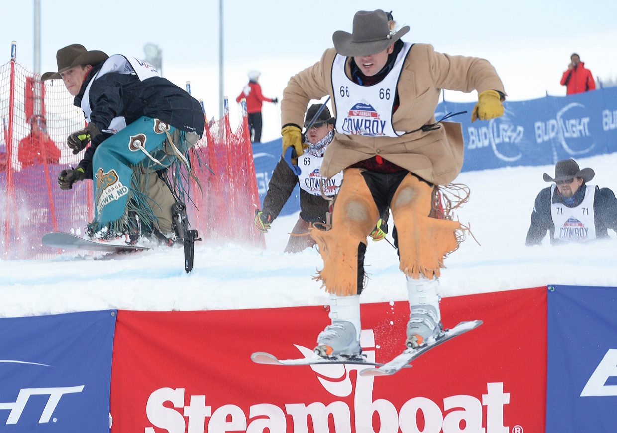Jesse Kirby, a saddle bronc rider from Kansas, leads the charge during the stampede portion of the 42nd annual Bud Light Cowboy Downhill at the base of Steamboat Ski Area Monday afternoon. Kirby won the stampede in the long-running Steamboat Springs tradition that attracts cowboys from the National Western Stock Show in Denver.
