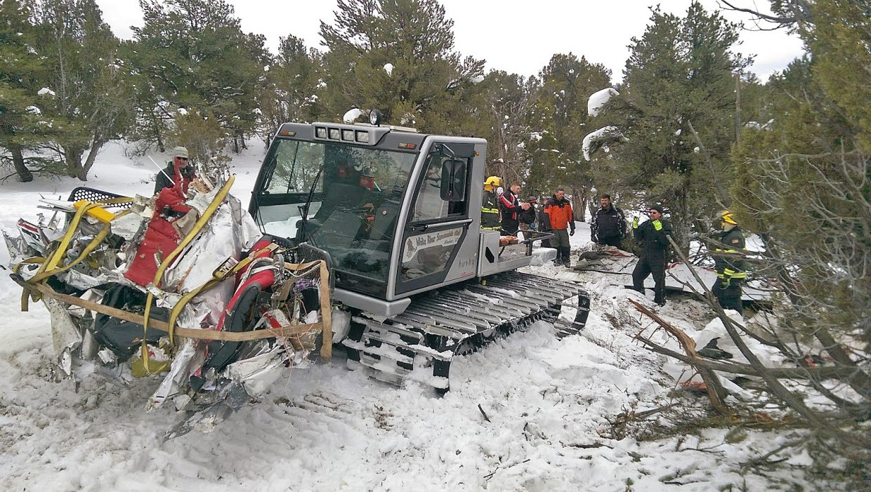First responders haul wreckage from a plane crash that happened near Meeker on Thursday.