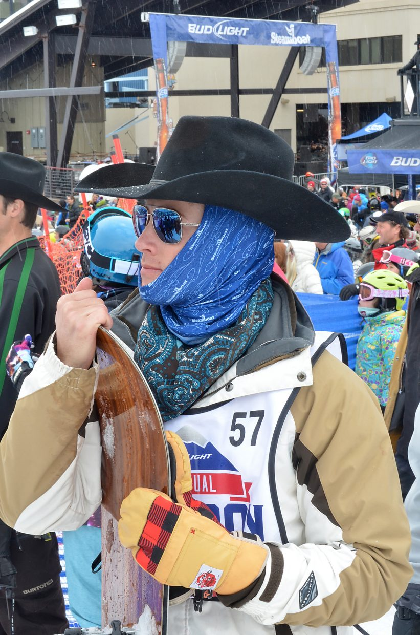 Saddle bronc rider Chad Braden of Welch, Oklahoma, wore both his glad rag and a buff to ward off a little snow squall after taking part in the 41st Bud Light Cowboy Downhill at the Steamboat Ski Area Monday.