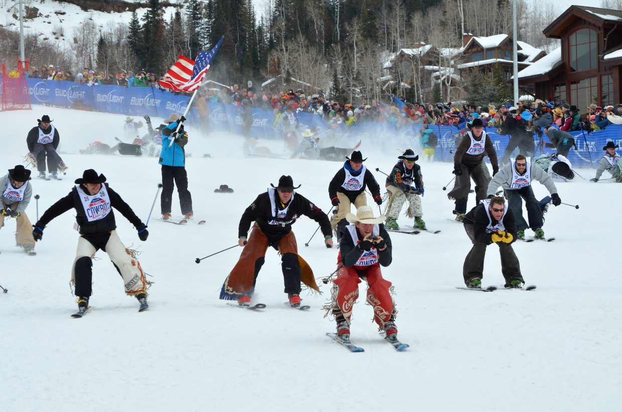 Jed Moore of Rangely, wearing a pair or red chaps, leads the pack to the finish line in the stampede that concluded the 41st Bud LIght Cowboy Downhill at the Steamboat Ski Area. The dual slalom race was won by Marc Gill, a bull fighter from Laramie, Wyoming last year. This year, the 42nd Cowboy Downhill will take place on Monday at the base of the ski area.